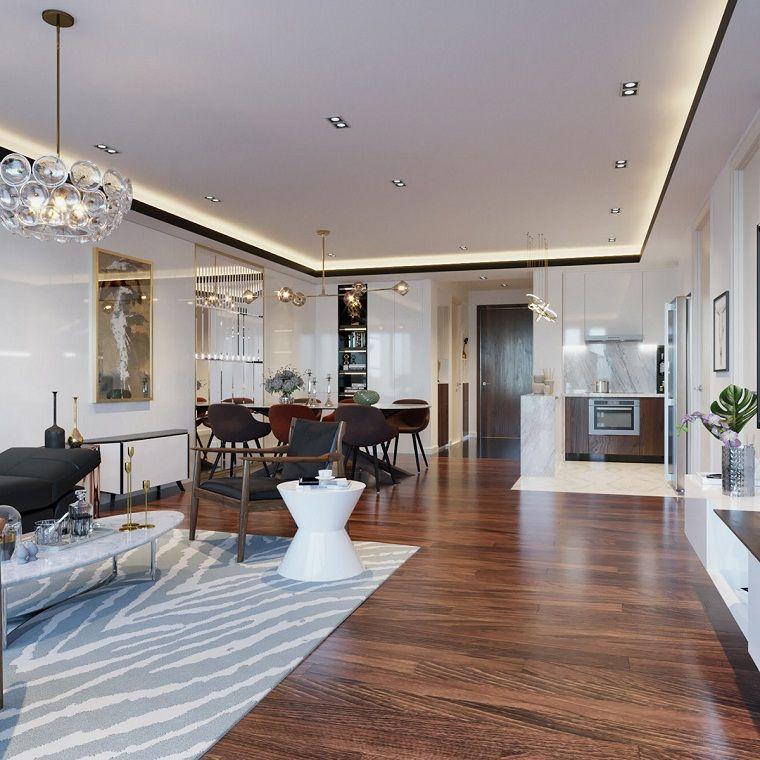 arredare salotto e sala da pranzo insieme pavimento in legno con tappeto bianco grigio