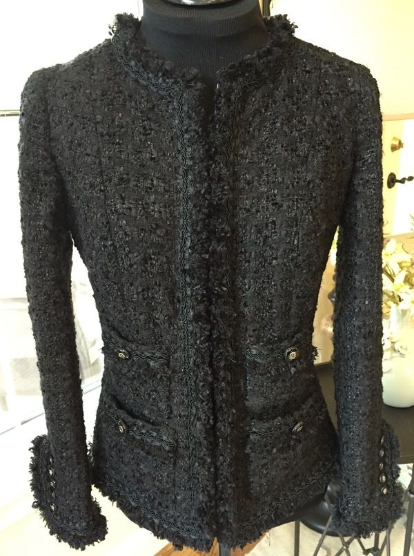 Linton Tweeds boucle is from their online shop; silk for the quilted lining is from our local store. Trim is self-made fringe folded in half for double thickness and layered with narrow decorative braid from M&J Trimming. Lengthy bit of hand sewing. Glass buttons are also from M&J.