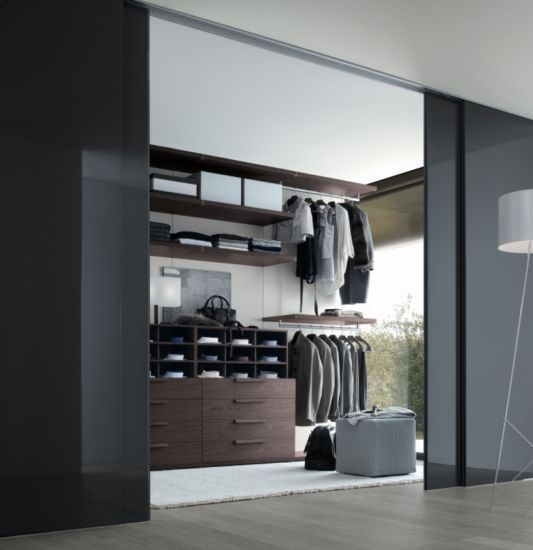 Luxury Bedroom Walk In Closet Design With Gray Gloss Sliding Door Also Beige Shag Rug Area Plus Brown Wall Mounted Hanging Clothes And