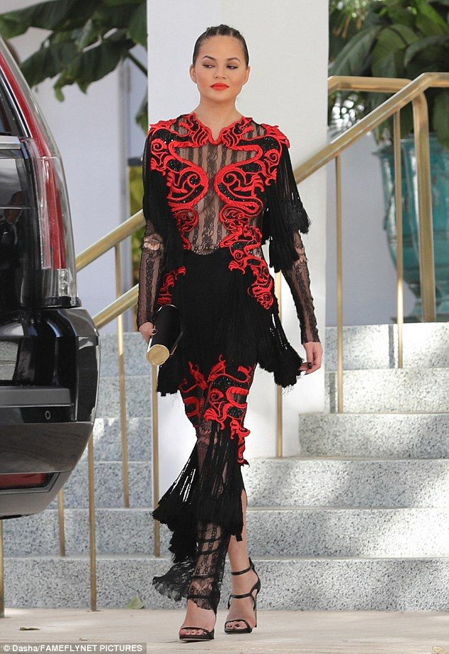 Fringe benefits!The 31-year-old model looked striking as she left her hotel in a Raisa & Vanessa gown that featured racy sheer lace panelling across her chest to highlight her buxom bust