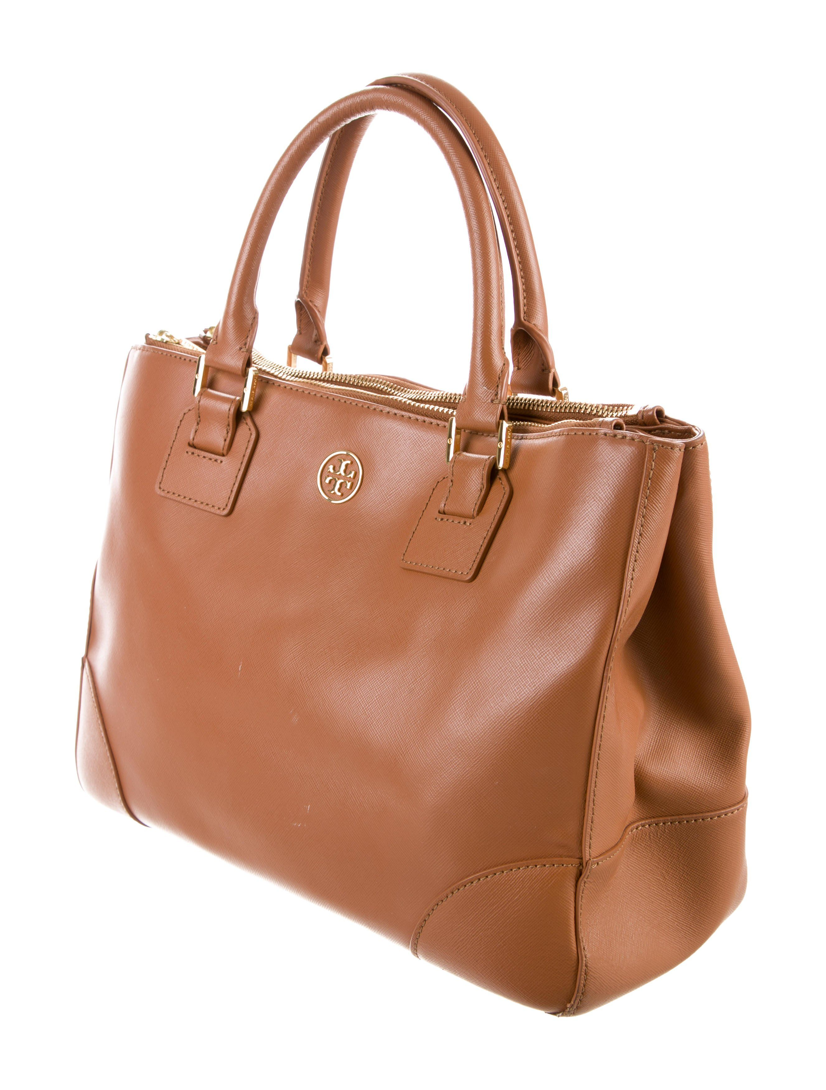 1fa2b568fb Brown saffiano leather Tory Burch Robinson Double Zip Tote with gold-tone  hardware, dual rolled top handles, single detachable flat shoulder strap  with buck