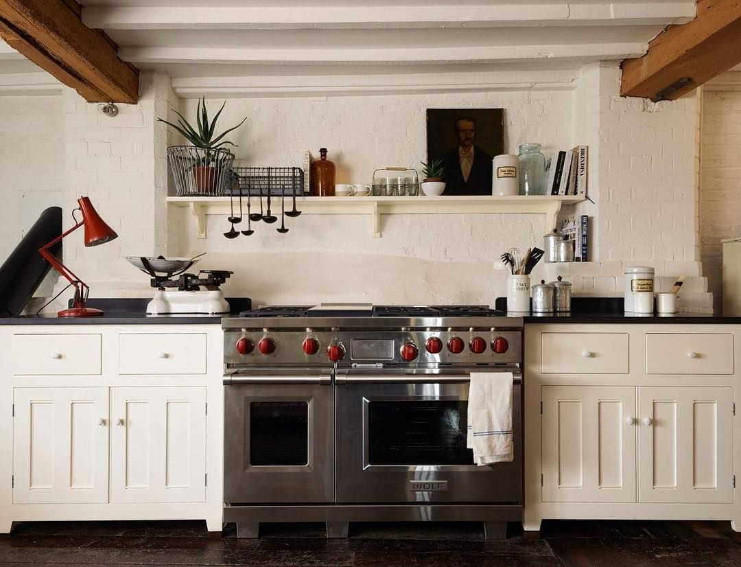 White Cabinets with a chunky Wolf range deVol Kitchens ...