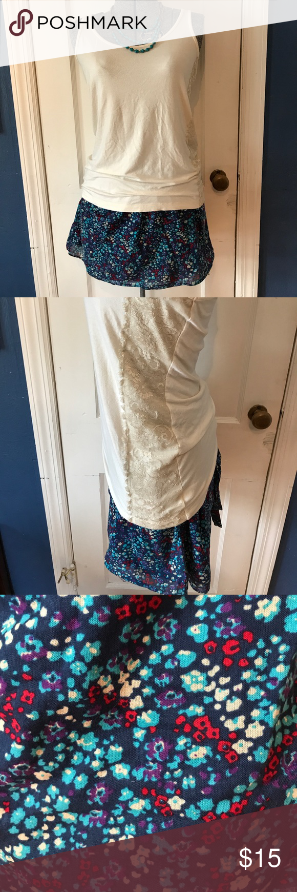 Full outfit!!! Simple yet unique cream colored tank top with a thick lace accent down the left side. The skirt is perfect for spring and summer with a nice floral design and tie in the back. The skirt is fitted with a side zipper. The top is a size small and the skirt a medium Skirts Skirt Sets
