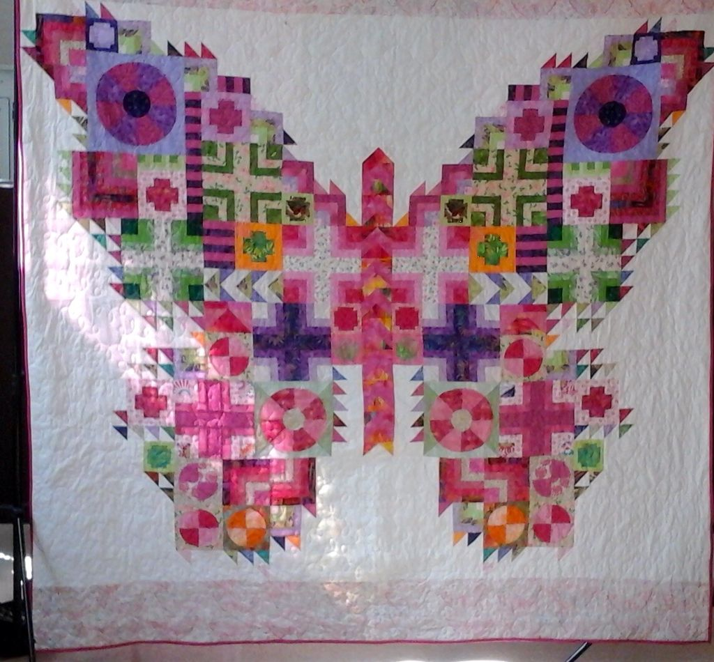 Butterfly quilt by MJD from Tula Pink pattern.