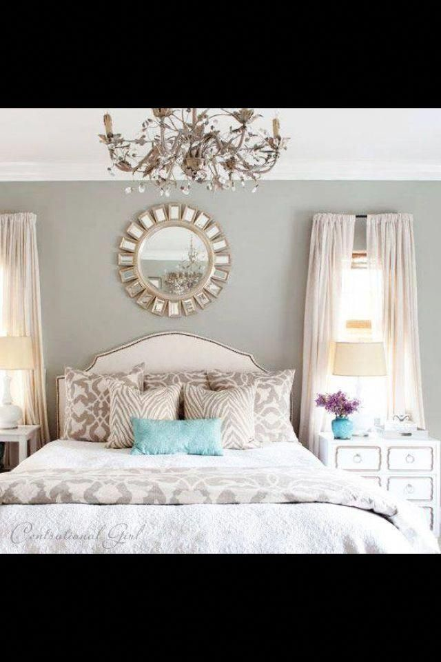 lovely bedroom in light gray and white with chandelier and mirror #bedroomcolors #graybedroomwithpopofcolor
