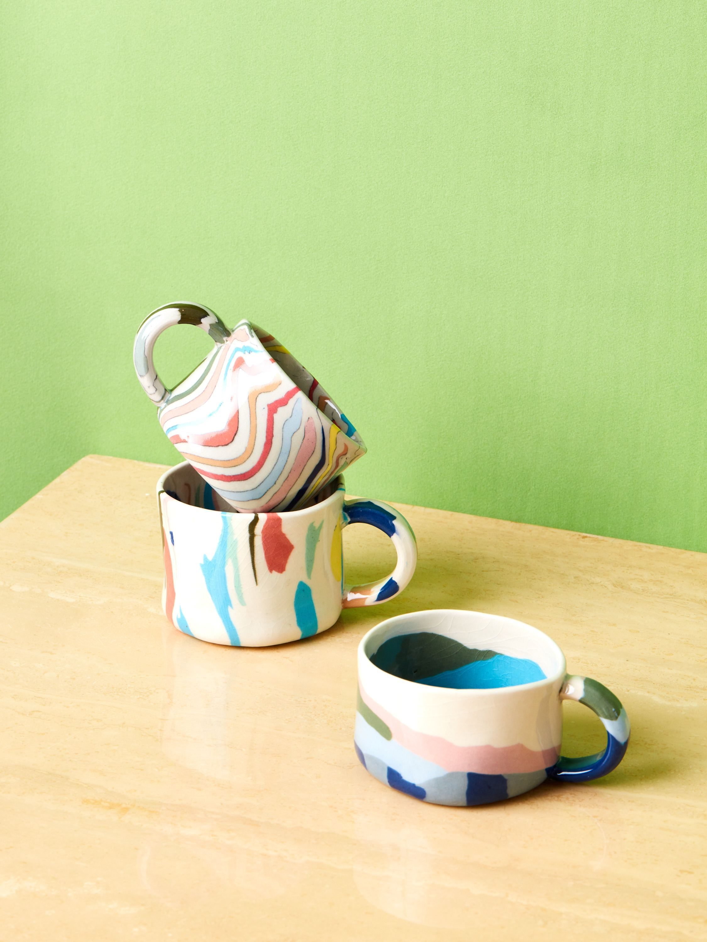 Handmade ceramic mugs by New York based ceramicist, Risa Nishimori. Created in the tradition Japanese nerikomi ceramic technique of mixing colored clays to create patterns, each piece is unique, the mugs you receive may slightly differ from the photos due to the nature of this ceramic technique. Price reflects the cost of one single mug. Approx 2.5