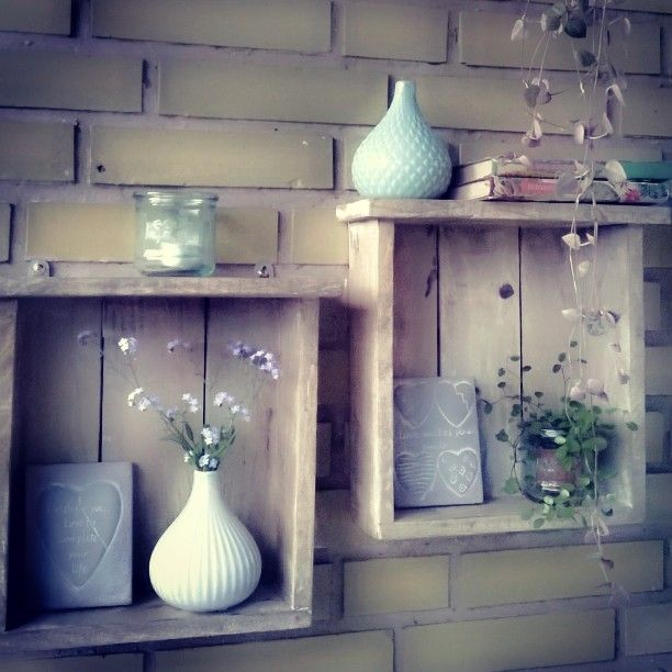 Book shelves made of drift wood, heart pics made in cement