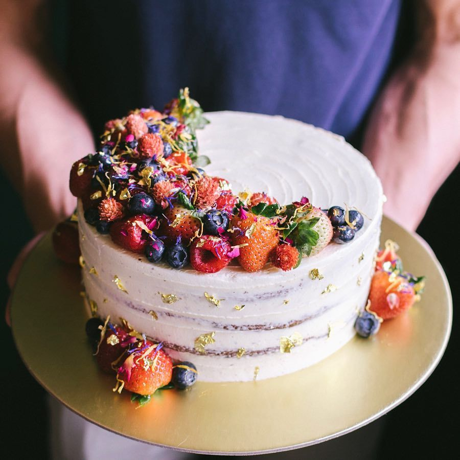 Rustic floral berry cake with edible dried flower petals ...