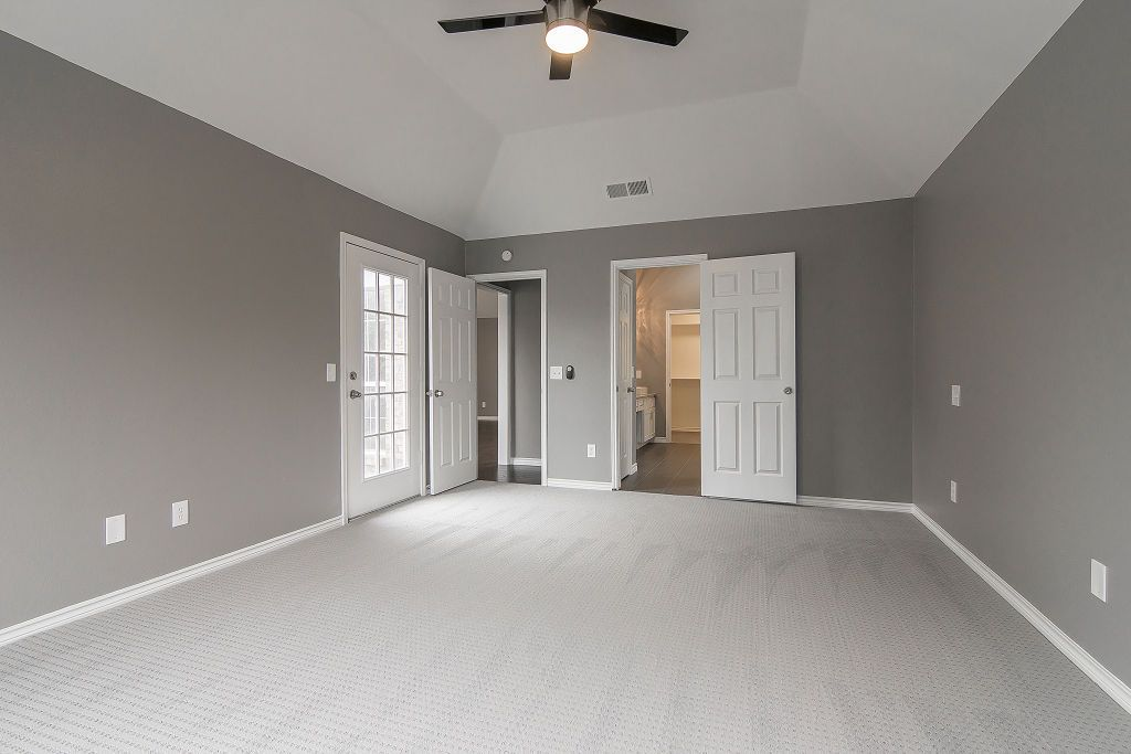 Master Bedroom Ensuite Patio Door Gray Walls Vaulted Ceiling White Trim Gray Carpet Modern Ceiling Grey