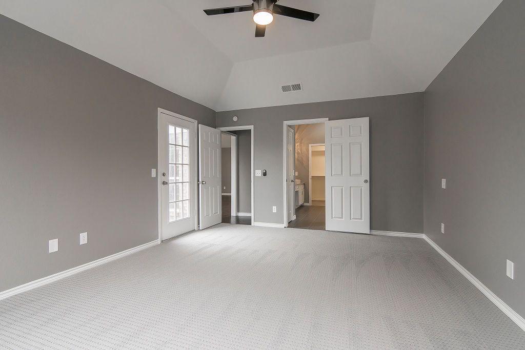 Master Bedroom Ensuite Patio Door Gray Walls Vaulted Ceiling White Trim