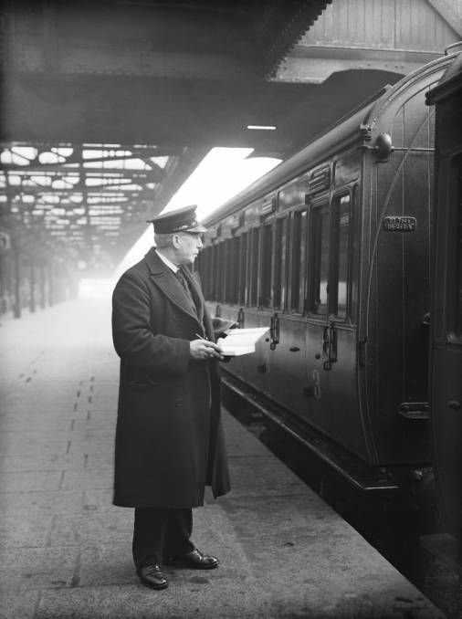 LMSR Guard at Nottingham Midland station, noting the weight of the train, 1936. The guard had to ensure that the train's weight was within the capacity of the engine assigned to the job. The guard's main responsibilities were: the safety of the train and its passengers and the punctual running of the service.