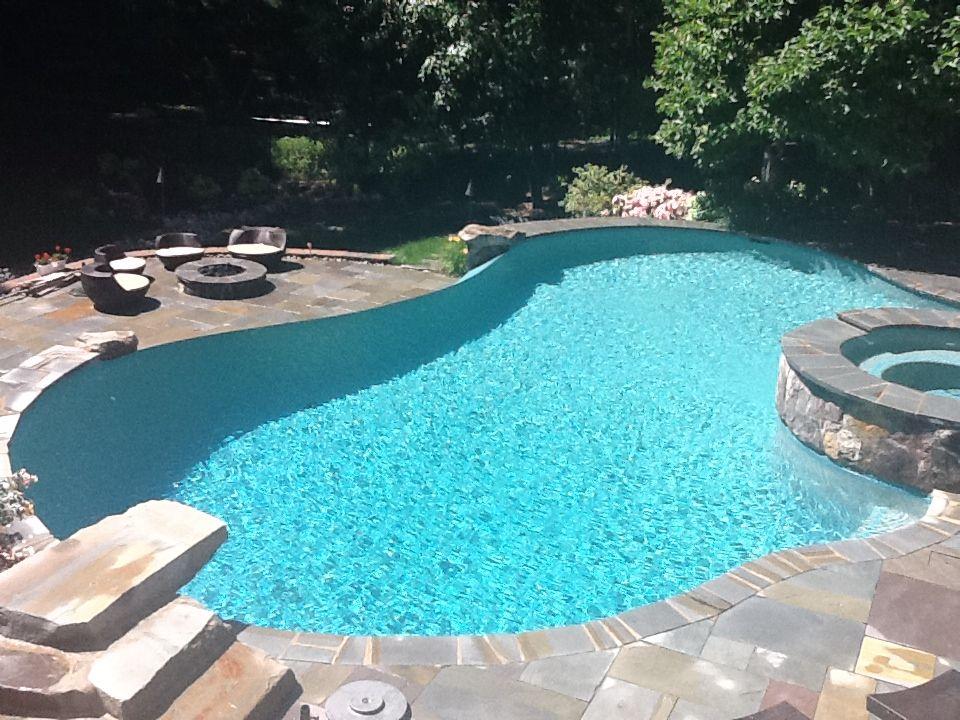Vanishing Edge Pool With Spa And Natural Dive Rock Custom Swimming Pool Swimming Pools Backyard Backyard Pool