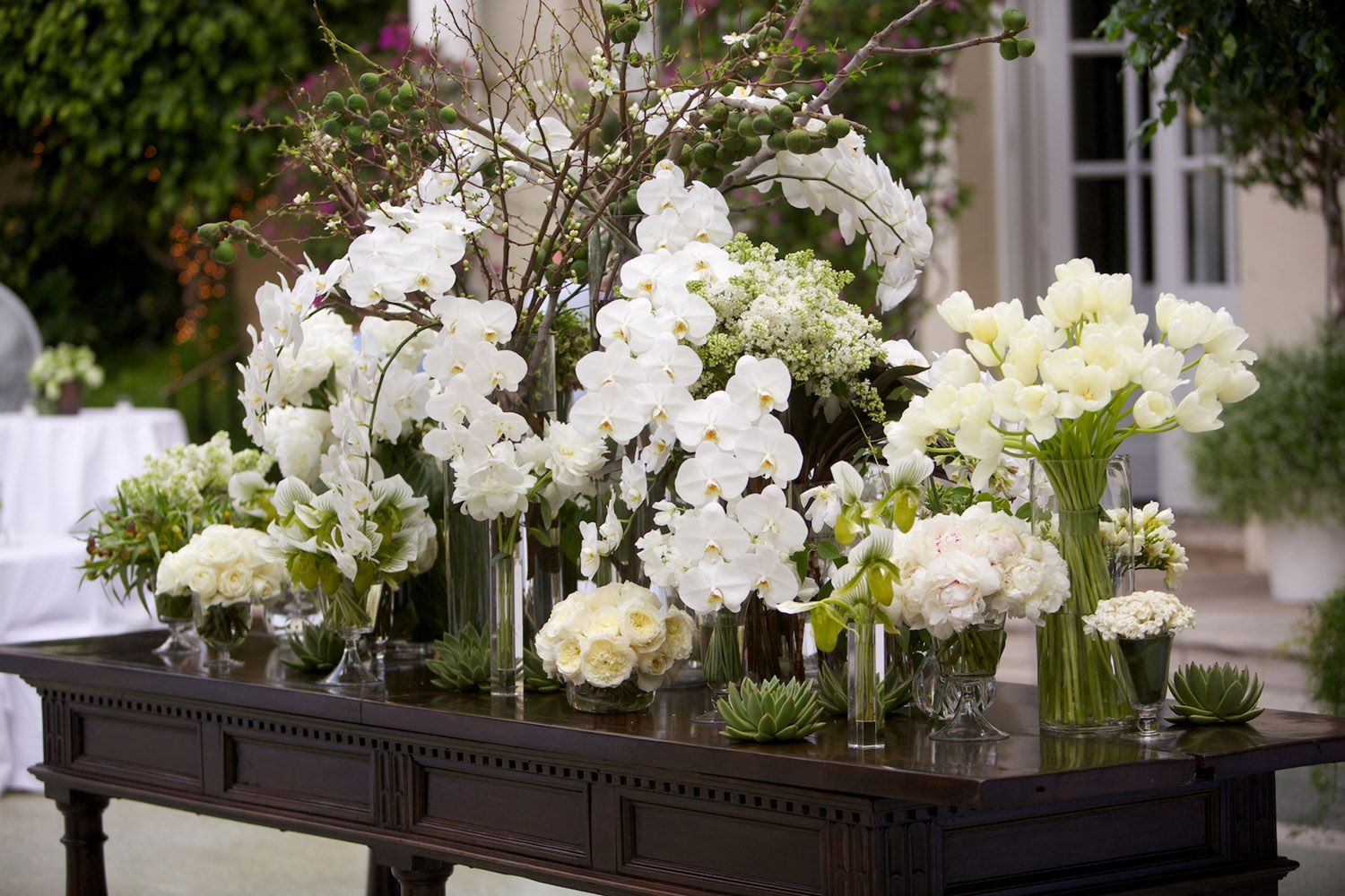 VAN WYCK Welcome Table Of White Flower Arrangements At A Palm Beach Wedding