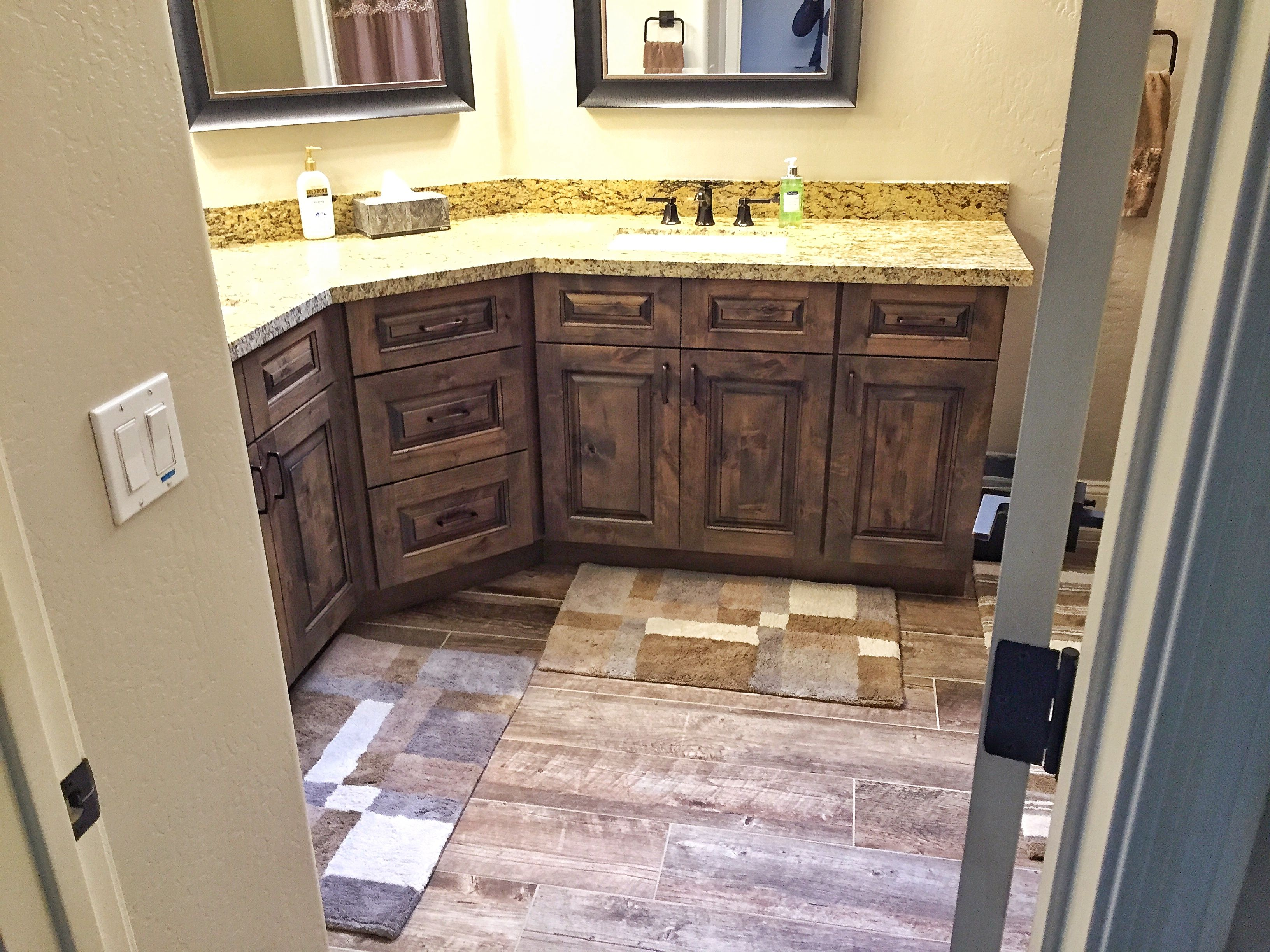 Rustic Wood Toned Vanities With Granite
