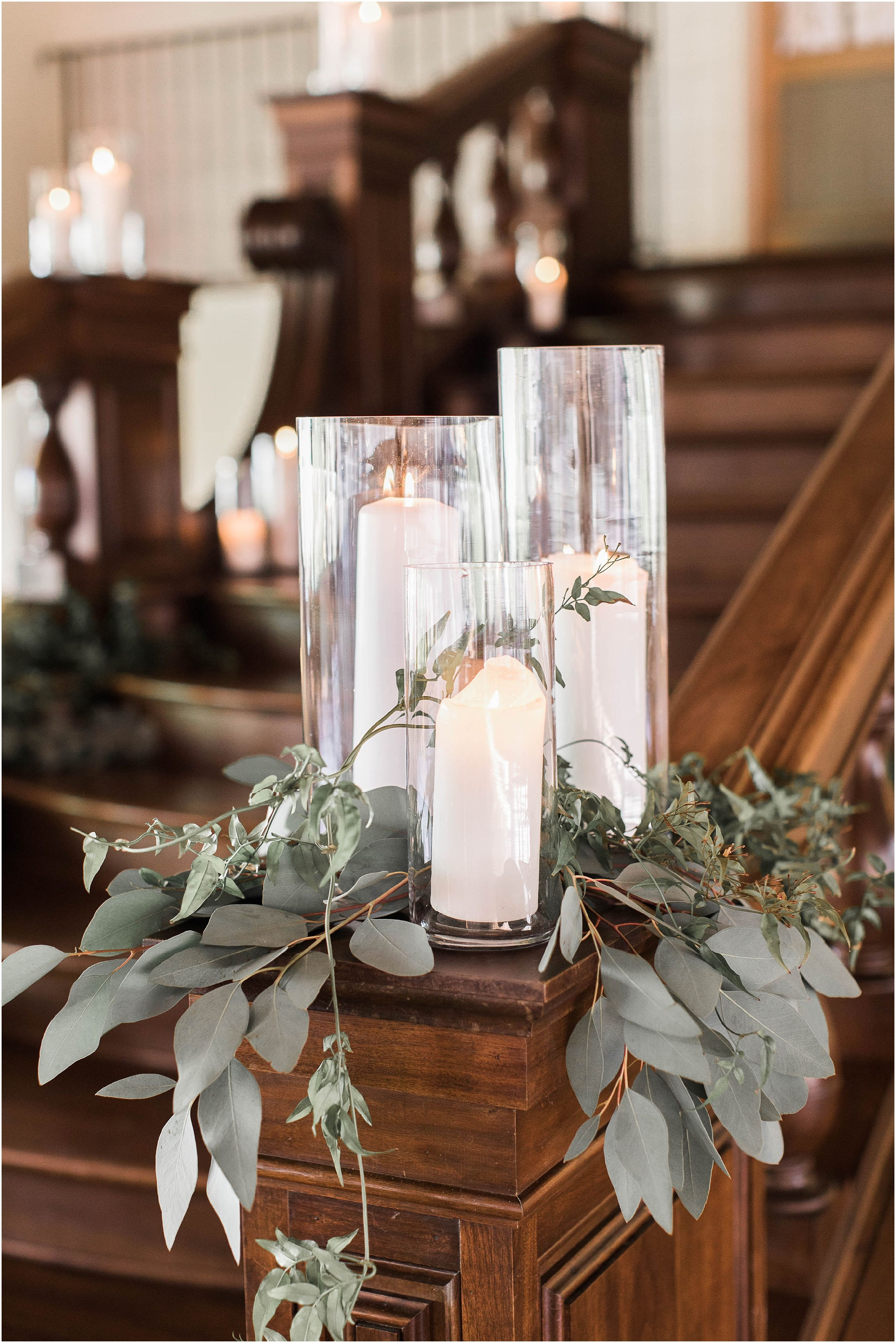 White Pillar Candles In Hurricanes And Gold Details Wedding Decor