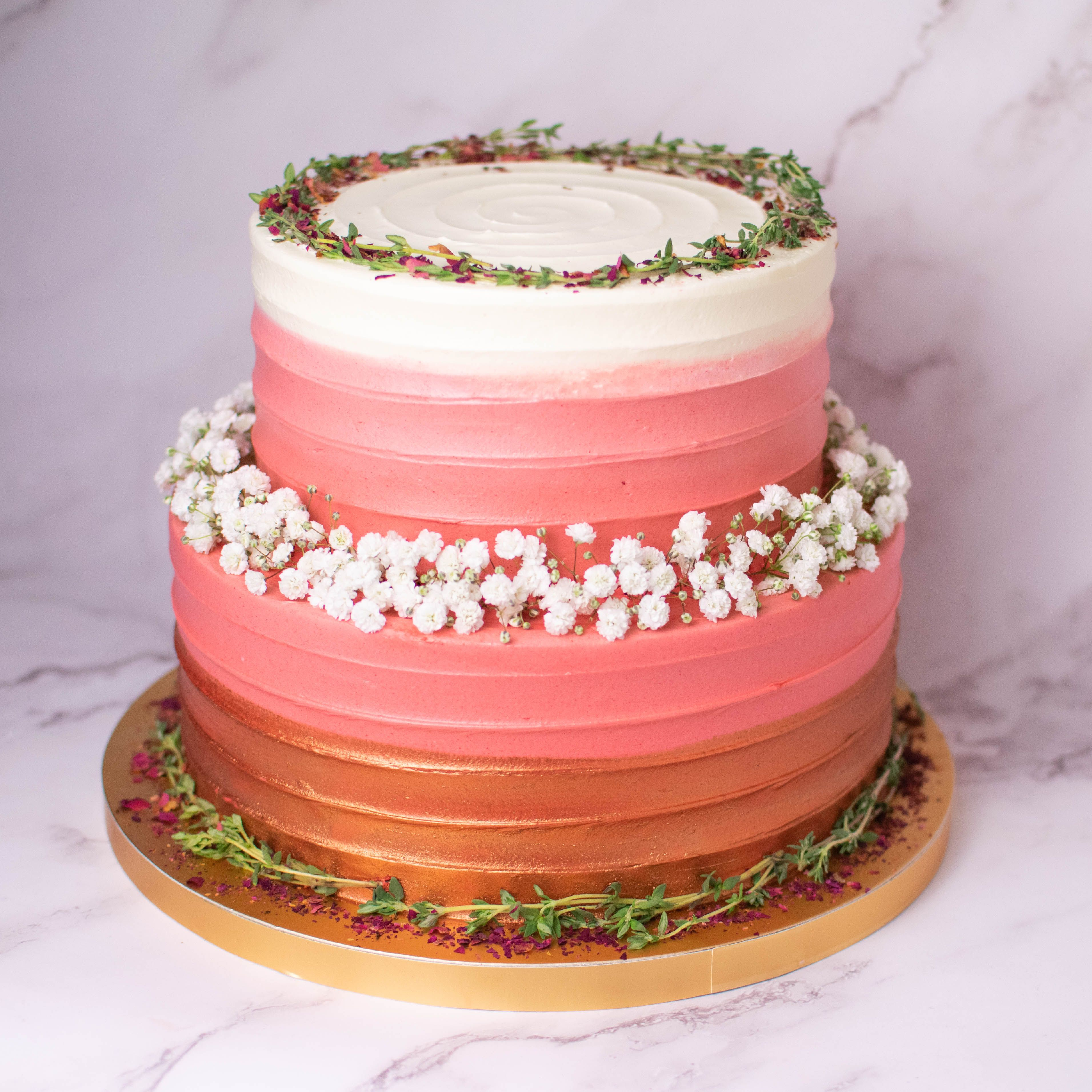 Two Tier Rose Gold Ombre With Thyme And Baby S Breath Rose Gold Cake Rose Gold Ombre Elegant Cakes