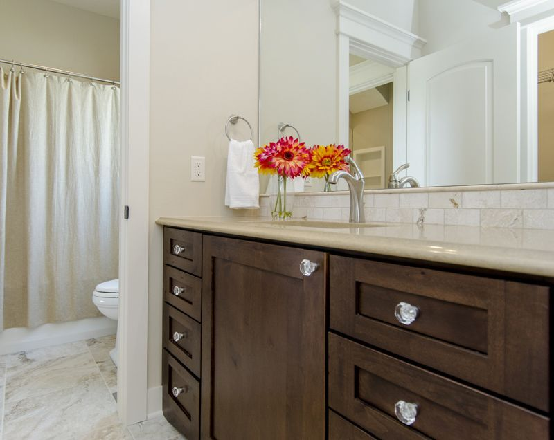 jack and jill bathroom with separate sink areasshared