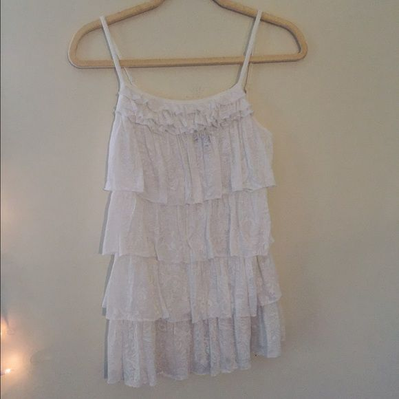 Express White Tank Top White tank top with ruffles and adjustable straps. The ruffles have a patterned design. Good condition. Express Tops Tank Tops