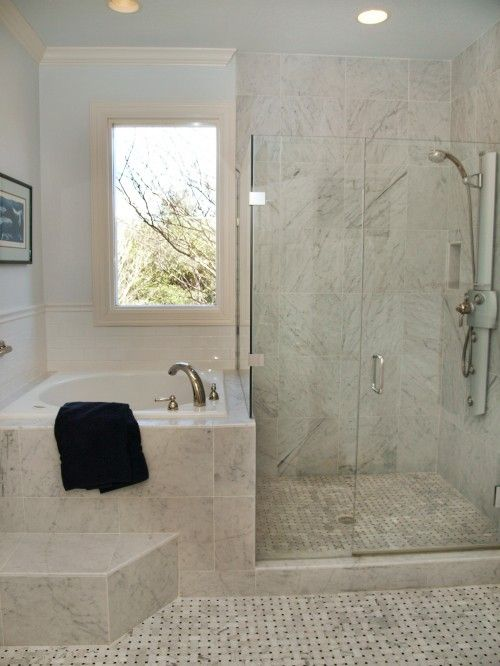 Interesting way to separate shower and bath in a small for New bathroom small space