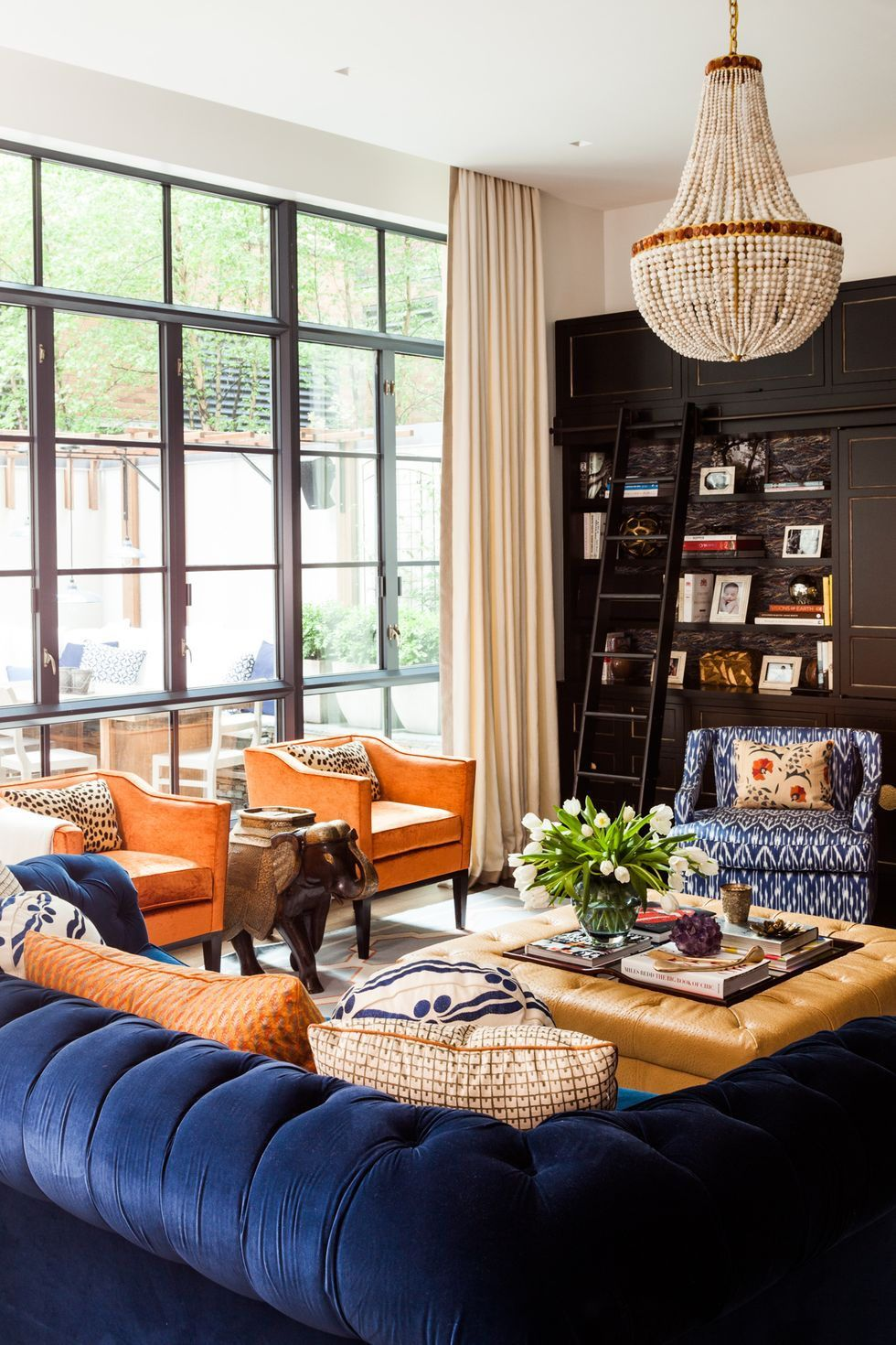 You Ll Love These 30 Colorful Family Rooms Living Room Orange Family Room Colors Blue Living Room