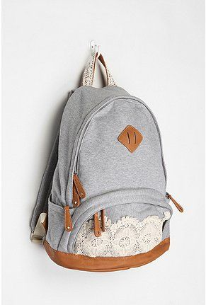 ebba435a9dfa Grey backpack with lace details. Cute bag from Urban Outfiters. school bag.  Urban Outfiters. But you could totally DIY this
