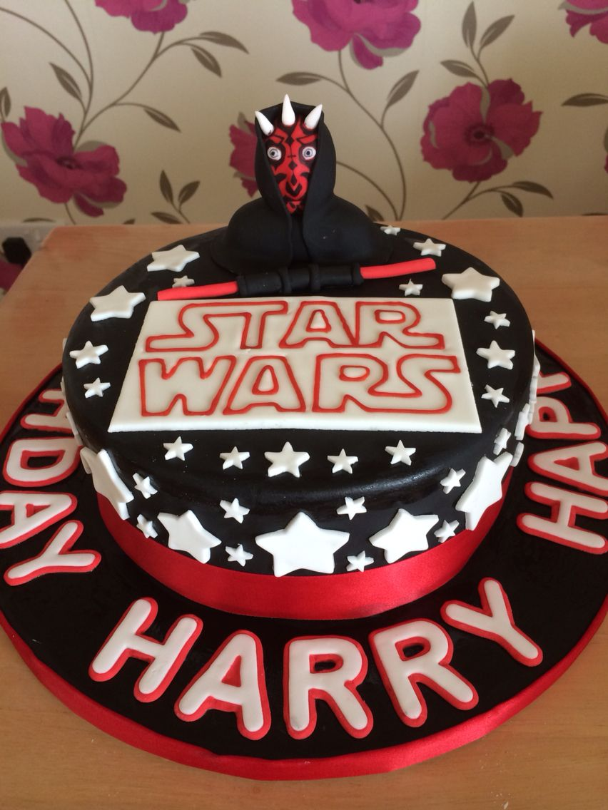 Darth Maul birthday cake for a friend's son's 5th birthday. Rich chocolate cake inside (BBC good food wedding cake recipe) and all fondant icing covering and character (Renshaw's coloured fondant and Tesco white fondant).
