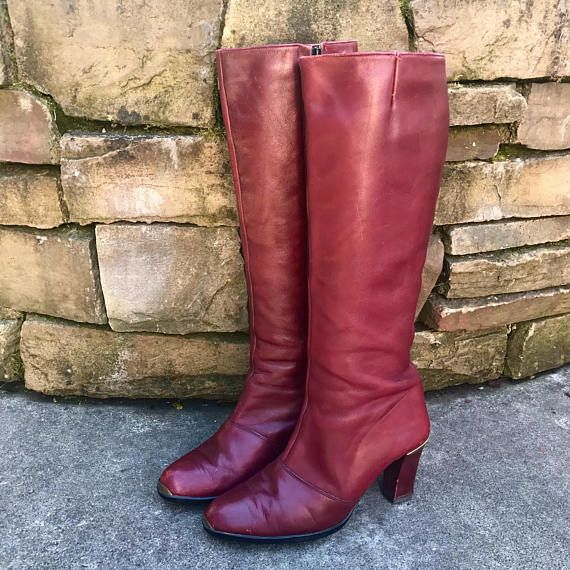 32fe288648d A fabulous pair of vintage Etienne Aigner knee high leather boots! These  boots were made in Spain and are constructed of supple dark maroon red  leather.