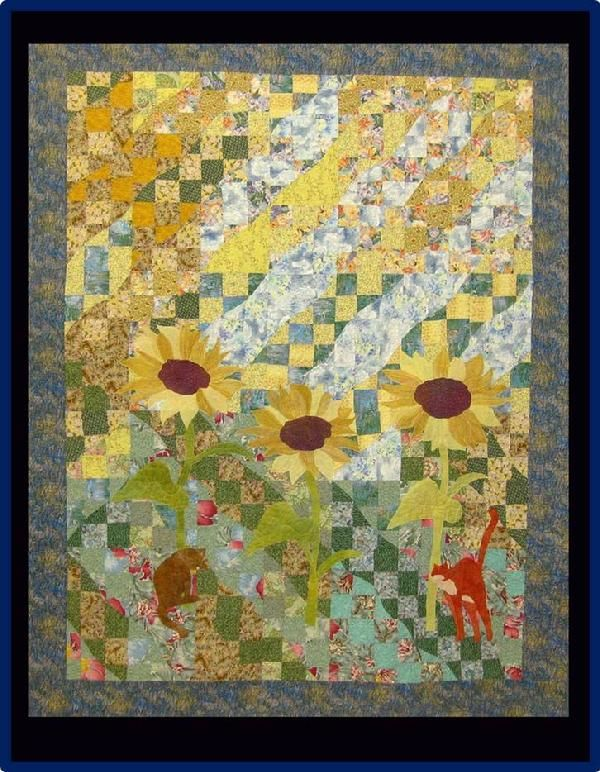 2 Cats in the yard, by Amanda Whitsel .  Prize winner at Cotton Patch quilt show 2013