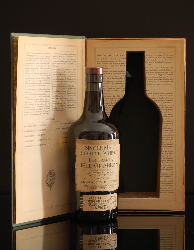 """The Arran The Smugglers'  'The Illicit Stills'  Note: The first release in a new series from the Arran distillery! The Smugglers' Series Volume 1 (""""The Illicit Stills"""") is an homage to the history of less-than-legal distillation on the Isle of Arran in the 18th and 19th century. The single malt Scotch whisky is crafted from a selection of their malts, including unpeated and heavily peated stock, whisky matured in old bourbon barrels and whisky fully-matured in Port pipes! A fantast"""