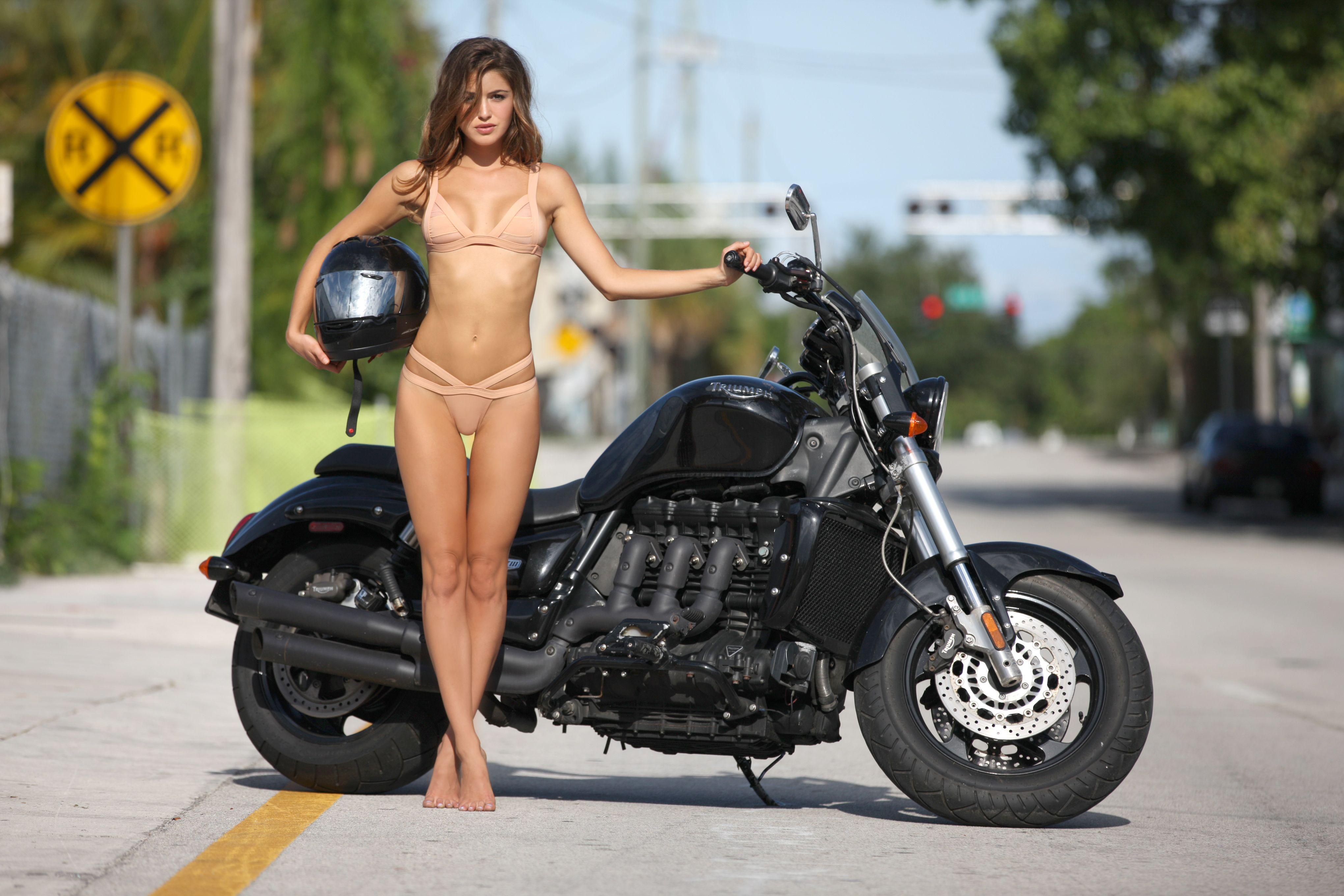 Naked women on bike