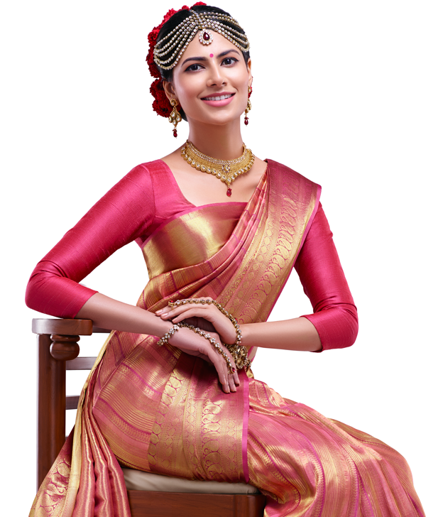 A bright color plain blouse is a Good combination for golden silk saree