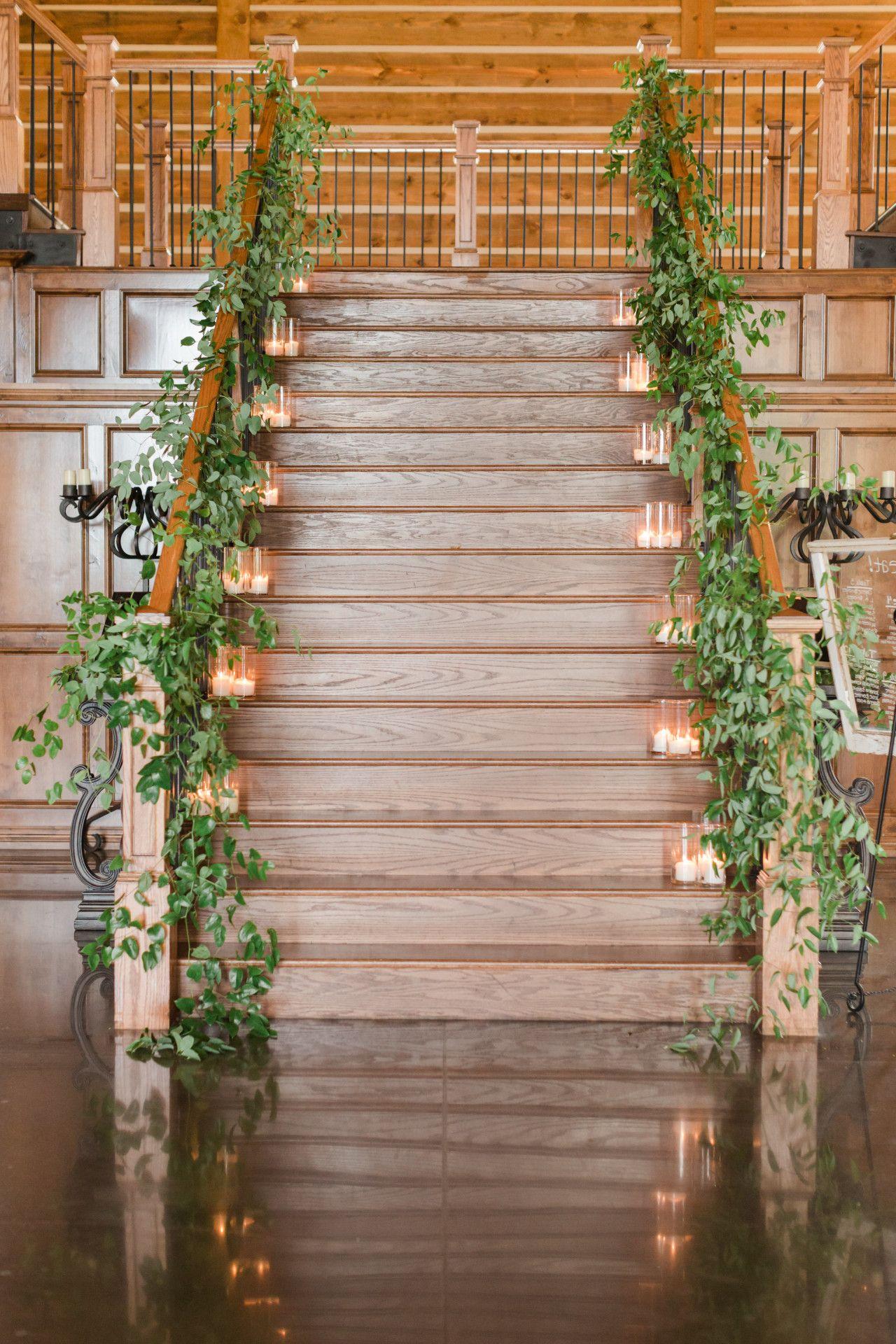 Latest wedding decorations 2018  wedding staircase decor with greenery  candles  elegant wedding