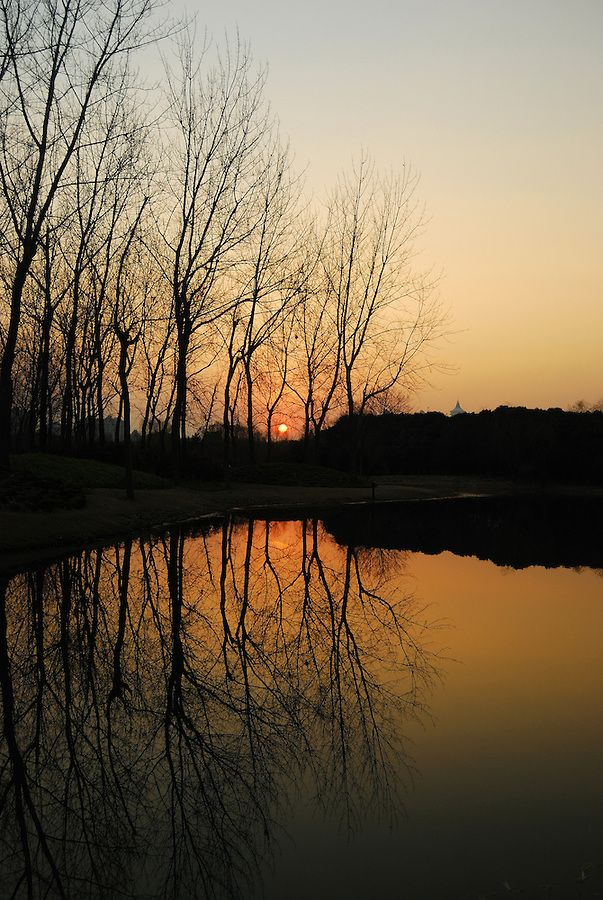 A Peaceful View Of Evening Sunset As The Water Reflection Of The With Images Sunset Photography Sunset City Photography Print