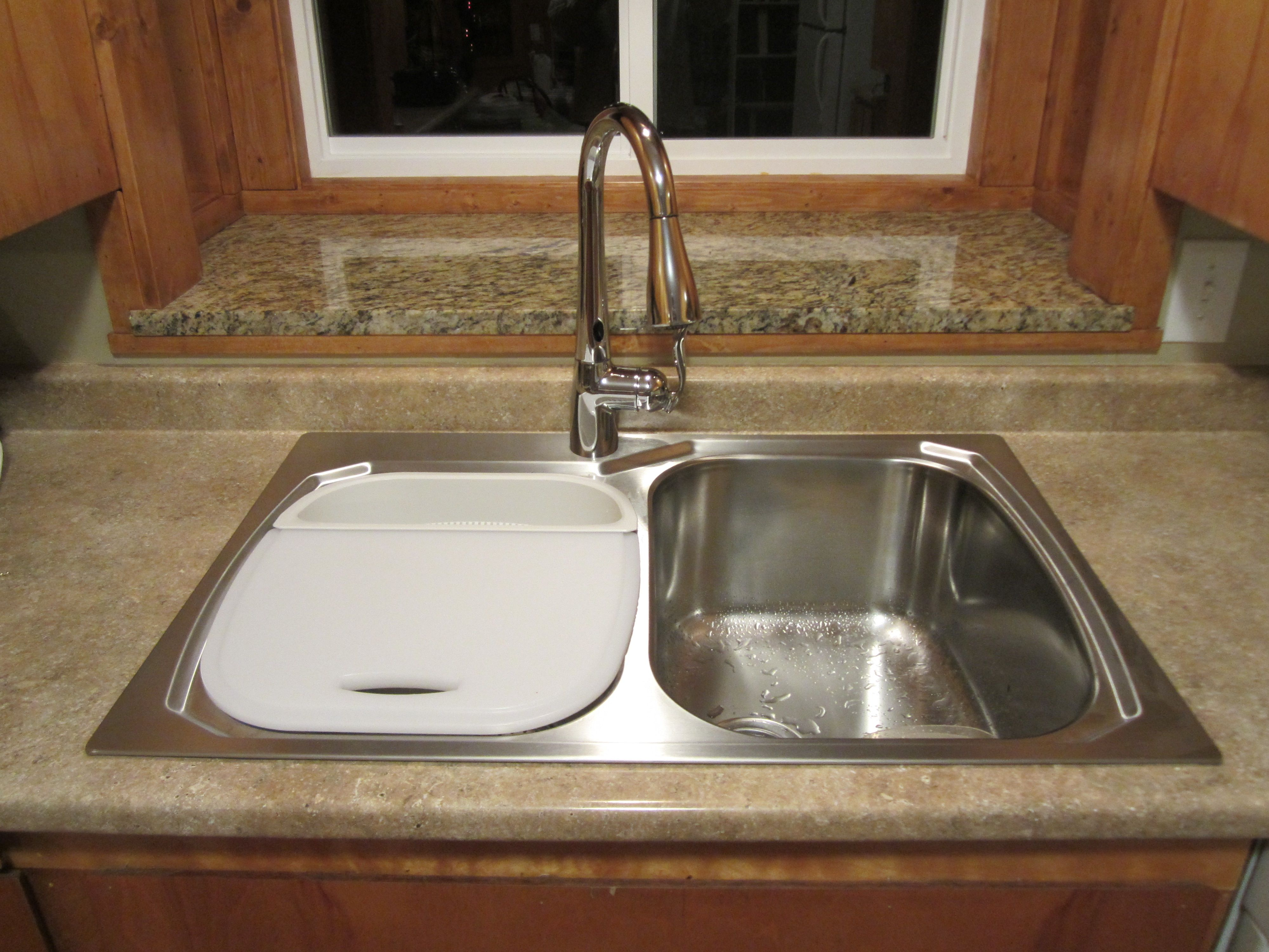 Stainless steel sink and Moen motion sensor faucet in chrome finish ...