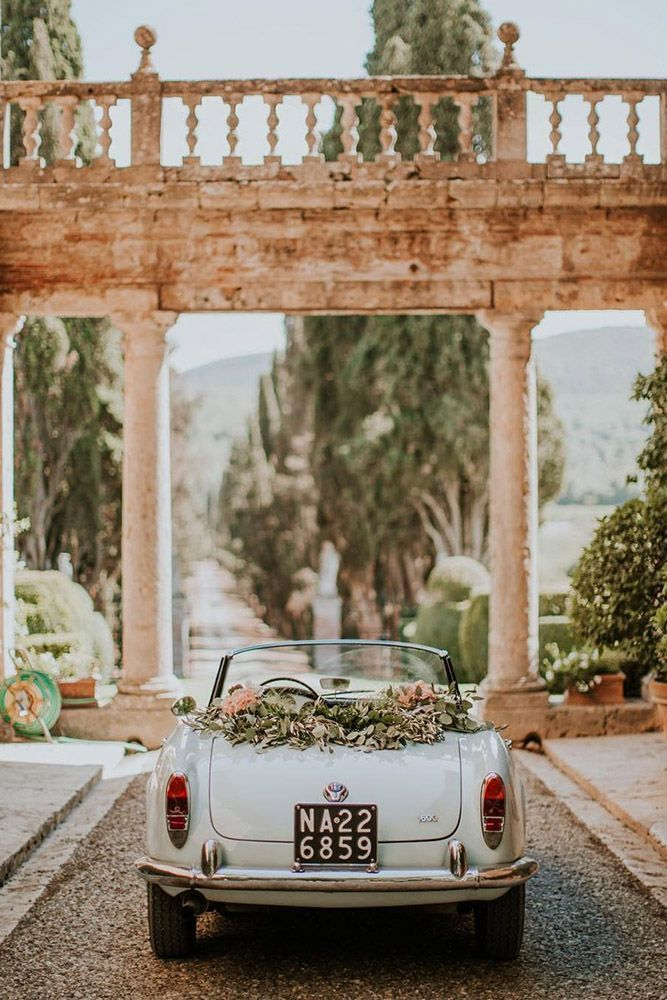 Retro European Getaway Convertible Decorated with Greenery ...