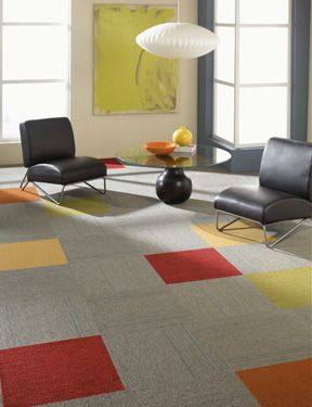 A few pops of colorful carpet tile really stand out against a grey ...