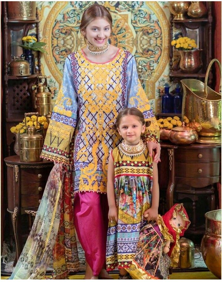 Pakistani Eid outfits by Ali Xeeshan for Warda. The little one looks like a carbon copy of the model Neha Rajput...must be her sister!