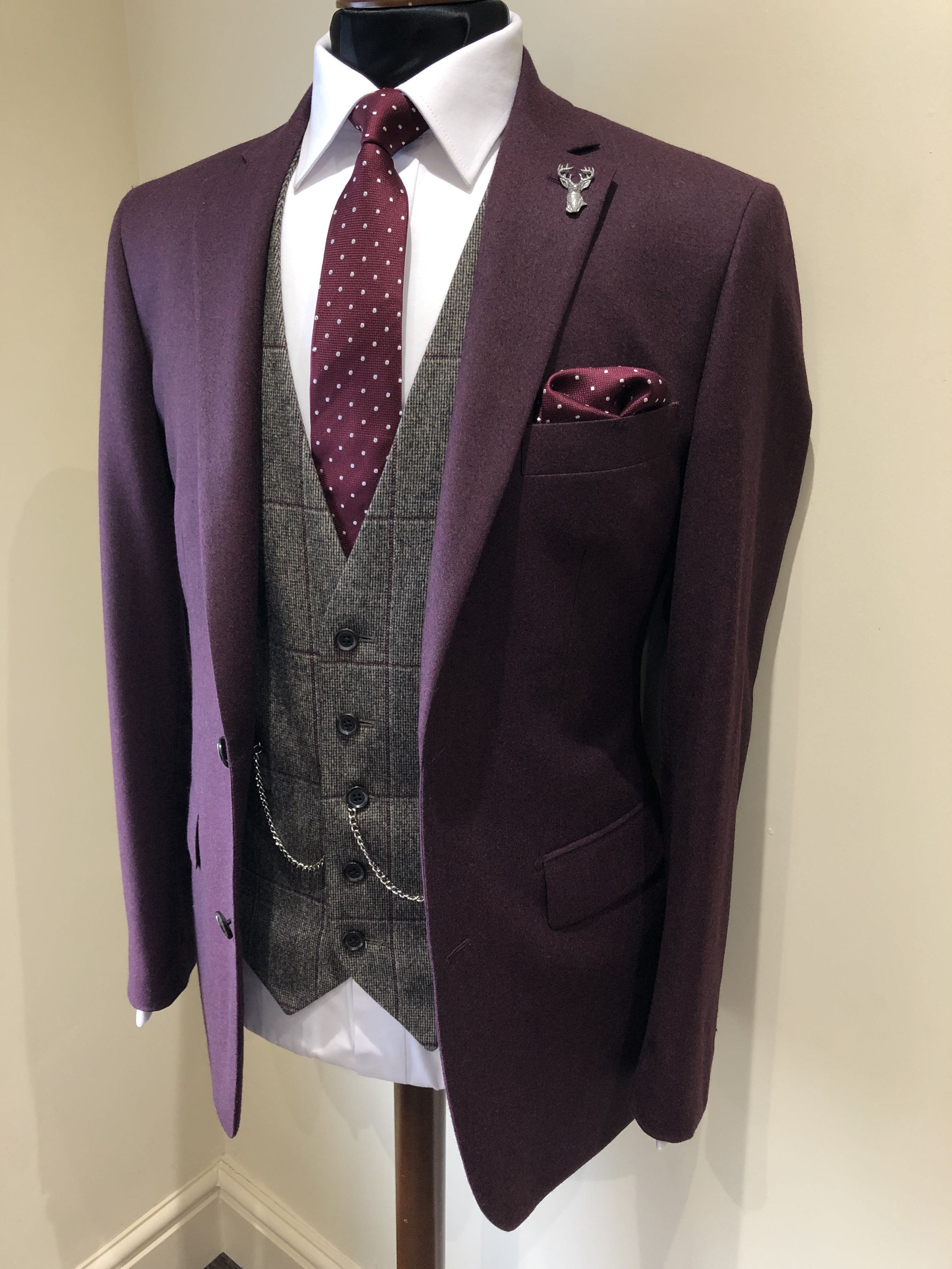 Check out our collection of burgundy suits. This colour