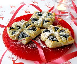 Pretty flower shaped puff pastry tarts with jam filling.
