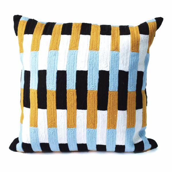 This bold embroidered cushion works great against a neutral backdrop, against layered blues or combined with rich russet colors. From Dusen Dusen. 100% Cotton. Side zip. Down fill insert.