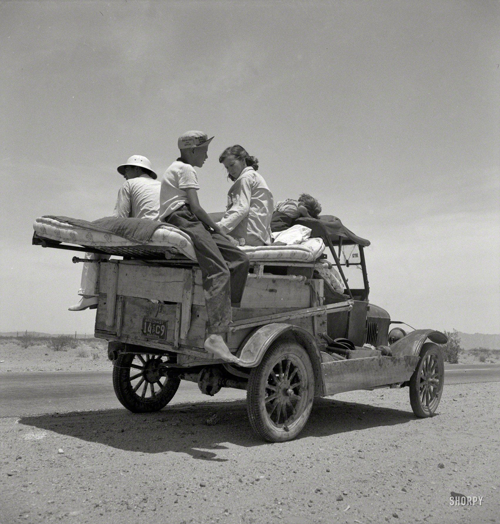May 1937. Migratory Family Traveling Across The Desert In