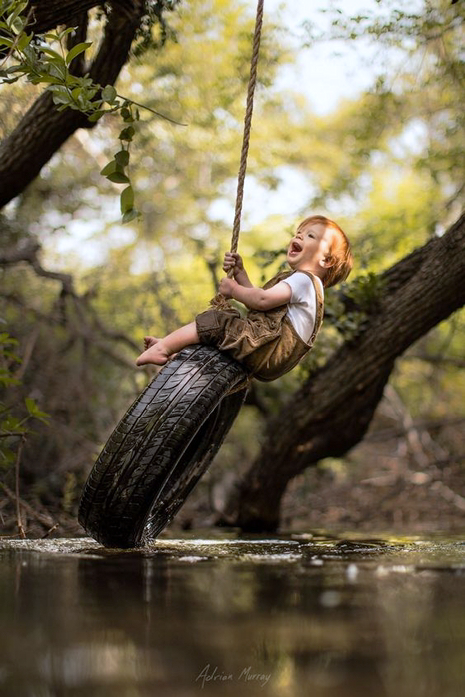 Murray, Adrian C - Boy On Tire Swing Over Stream (500px)