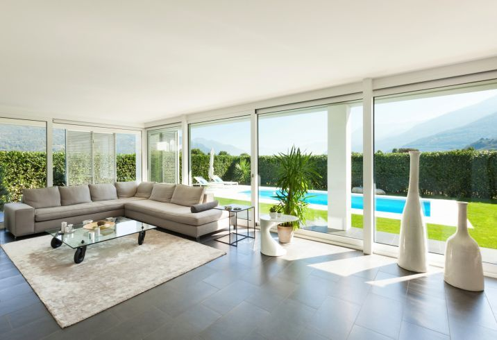 Modern Living Room Overlooking Pool With Sectional Couch And A