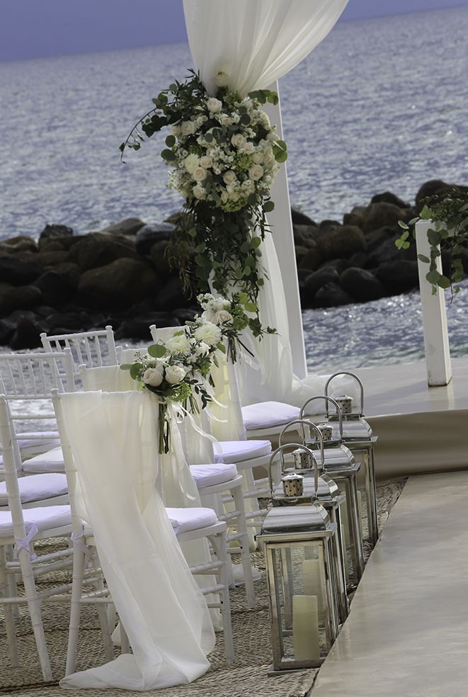 Flowers and chair down the aisle.