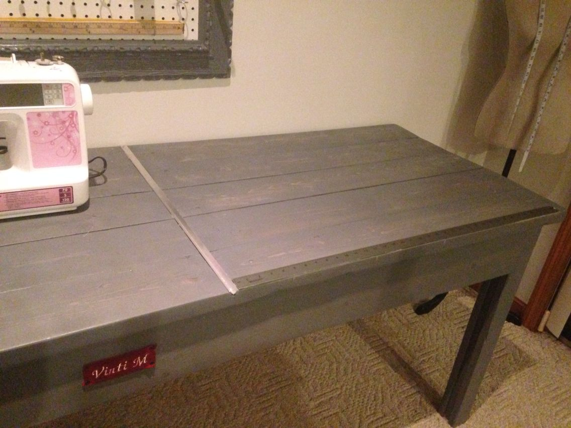 Diy sewing table with metal ridge for straight cutting and embedded ruler for measuring fabric up-cycled wood with cork board organizing tools frame also upcycled from thrift store ❤️ handmade sewing table