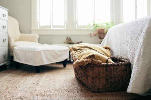 a basket at the foot of the bed. love it!