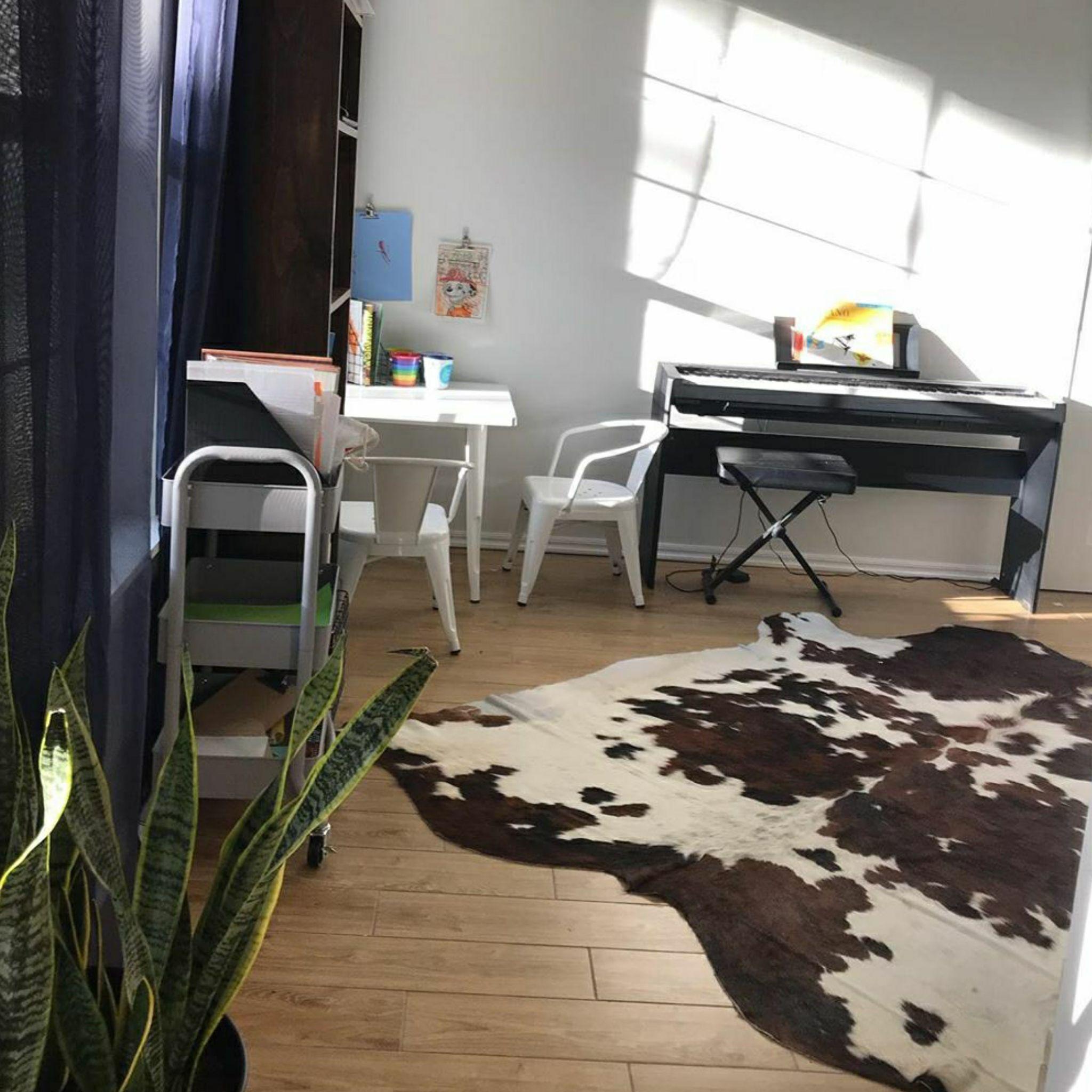 Cowhide rug in piano room cowhide