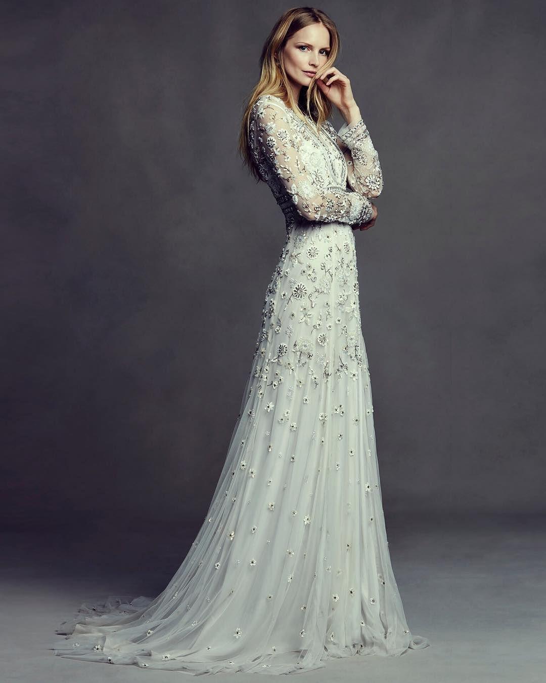 Slim fit wedding dresses  Those sleeves That beading The sleek silhouette Wow factor