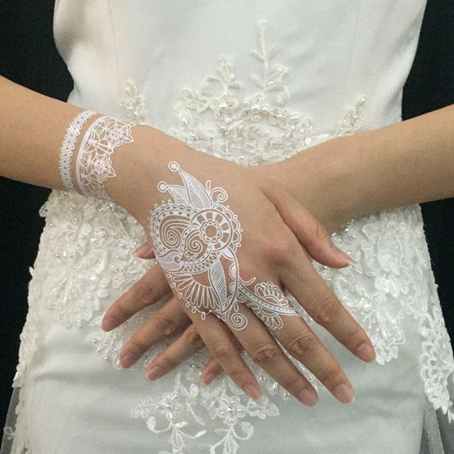 http://g04.a.alicdn.com/kf/HTB1r1EdIpXXXXcpXVXXq6xXFXXXK/4-Pieces-White-Henna-Lace-Tattoo-Stickers-Flower-Henna-White-Wedding-Temporary-Waterproof-Tattoos-Design-Sticker.jpg_640x640.jpg