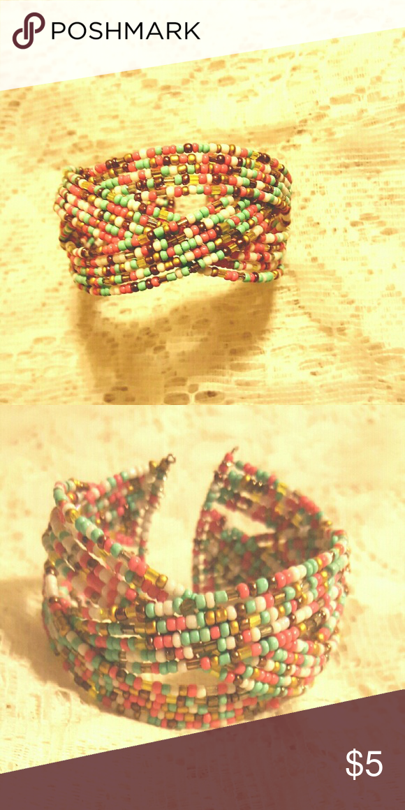 Seed bead Cuff Bracelet You are looking at triple strand seed bead bracelet with multiple spring colors...this bracelet with fit most wrist Jewelry Bracelets